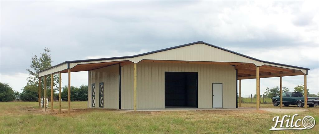 Barndominium with wrap around covered porch
