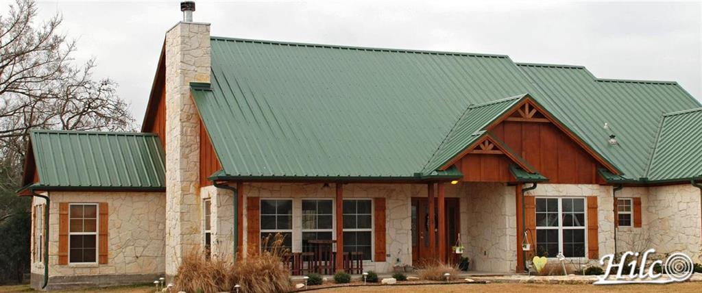 Green Steel Roofing with Cedar Trim