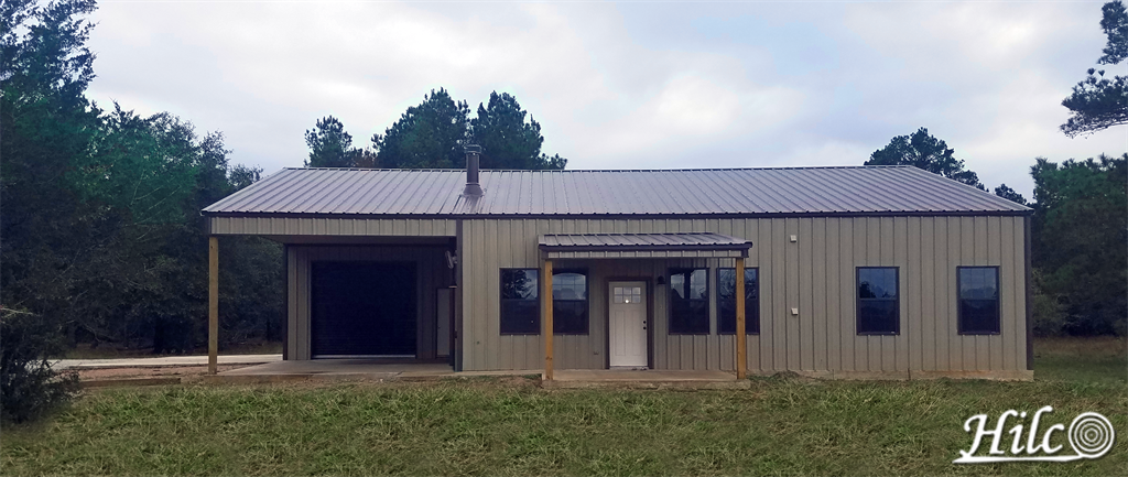Tan (brown) barndominium with dark metal roofing